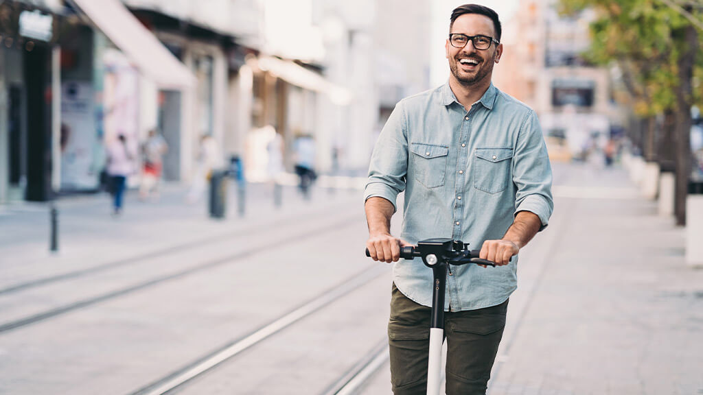Man riding an electric scooter.