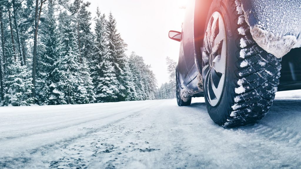 Close-up of winter tyres in the snow